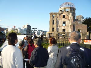 Receiving guidance at the Atomic Bomb Dome